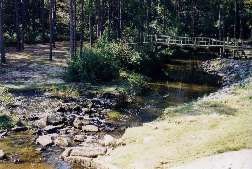 The spillway of the lake at Little River State Forest in Atmore, Alabama, looks almost like it did when built by the CCC in 1935.