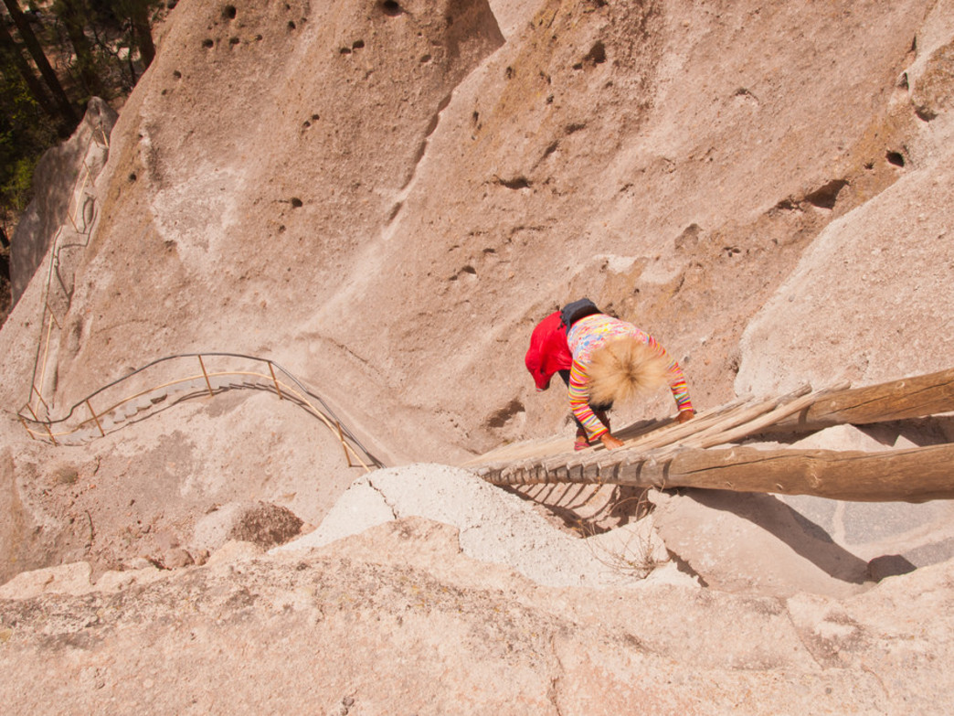 Scaling the ladders at Bandelier National Monument