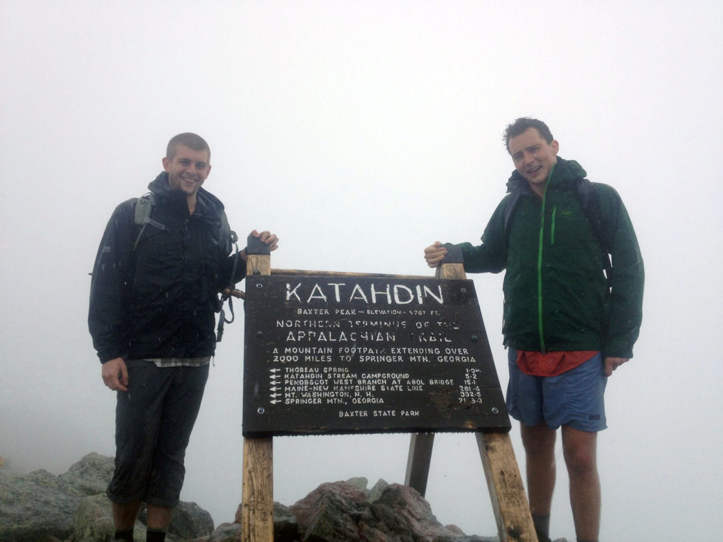 The journey begins! Fledgling John and Ry summit Mt. Katahdin on a foggy day.