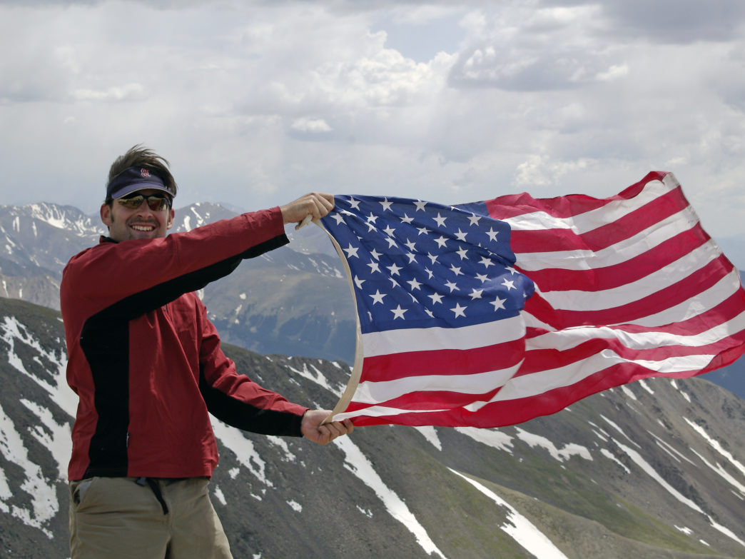 Old Glory on the summit of Colorado's highest peak, 14,440' Mount Elbert.