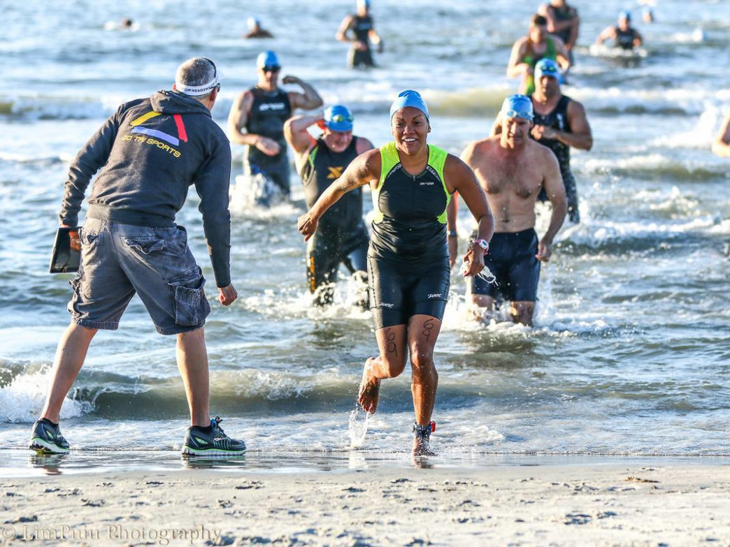 Olivetti encourages competitors during the annual Beach Bum Triathlon