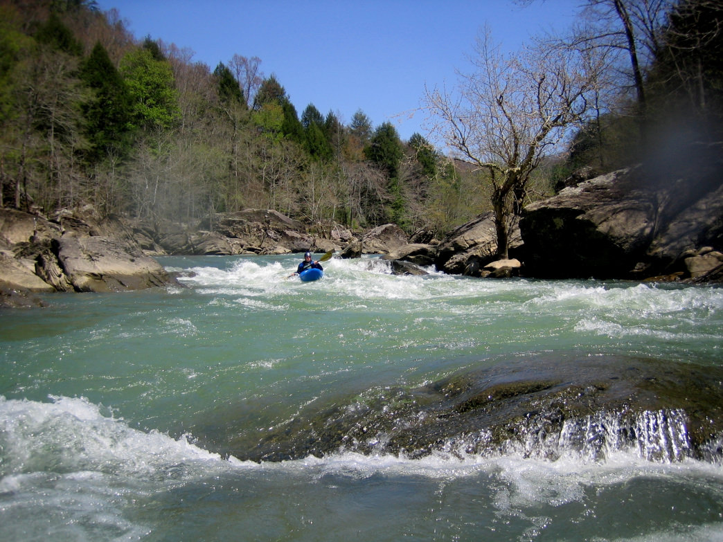 A kayaker approaches a tricky drop--not one to be underestimated or attempted without a lot of experience.