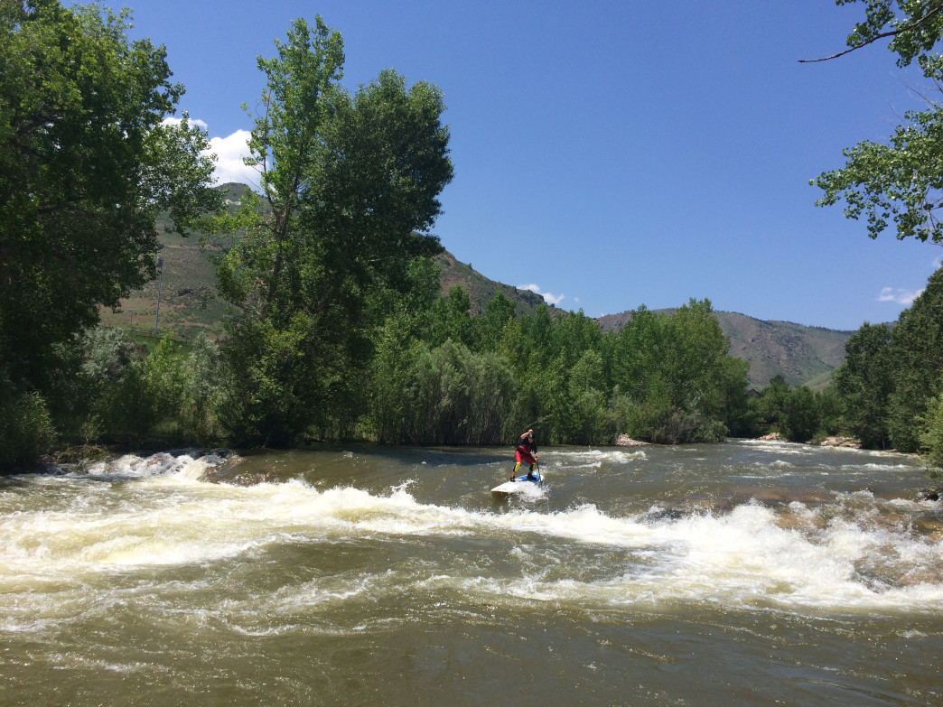 Put your SUP skills to the test at Golden's Clear Creek Whitewater Park.
