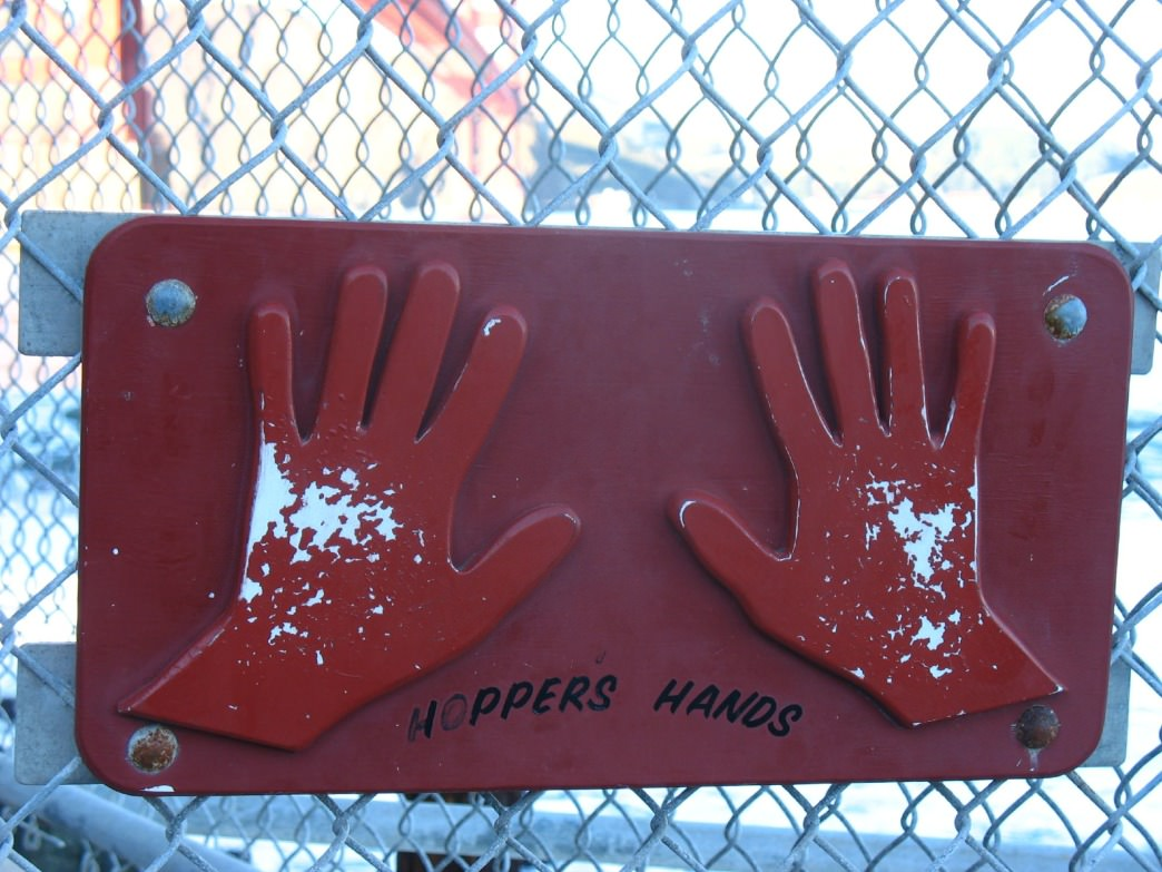 A previous version of the Hopper's Hands sign shows wear and tear.