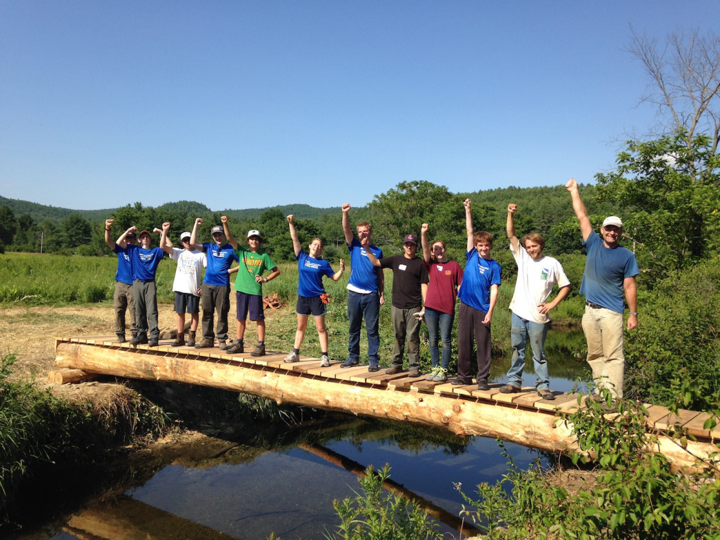Upper Valley Trails Alliance students working on a footbridge in Lyme, NH.