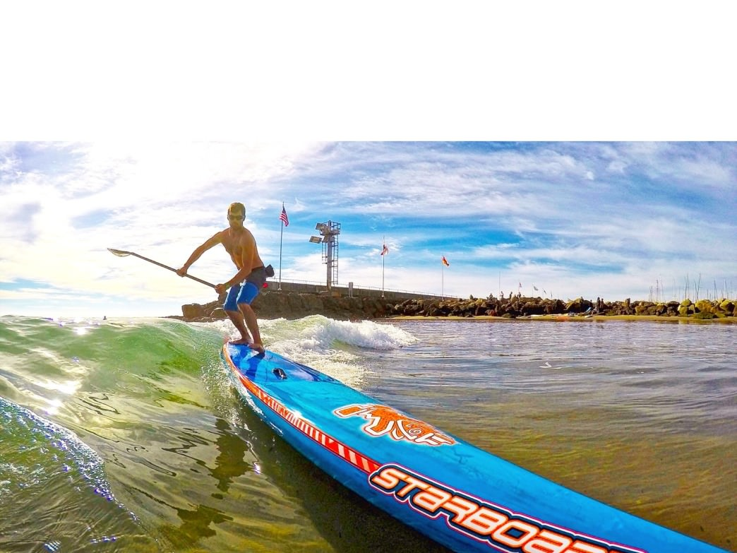 Dave Figlioli beats the small wave blues of Summer with a 14' Starboard race board and an open mind.