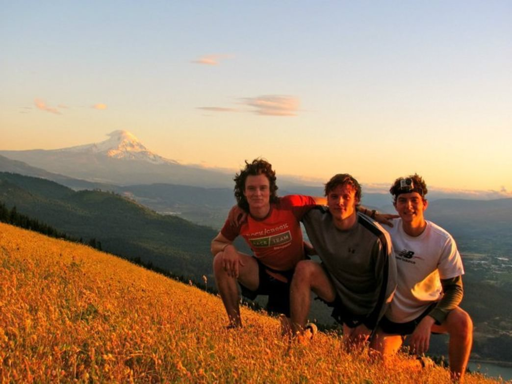Fynn, Russell, and Ry pose after an epic trail run above the Columbia River Gorge.