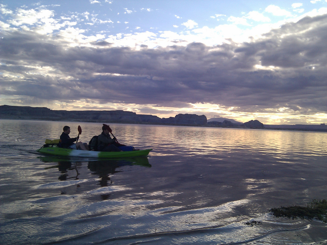 Viewing the sunrise by kayak on Lake Powell.