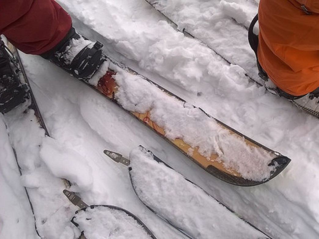 Splitboards can be taken apart to form ski-like parts (useful for ascending slopes); they are then reattached and can be used as snowboards for the trip down.