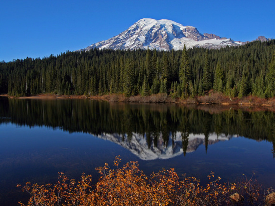 Mount Rainier is just one of the three volcanoes you'll see when hiking hut-to-hut via the Mount Tahoma Trails Association.