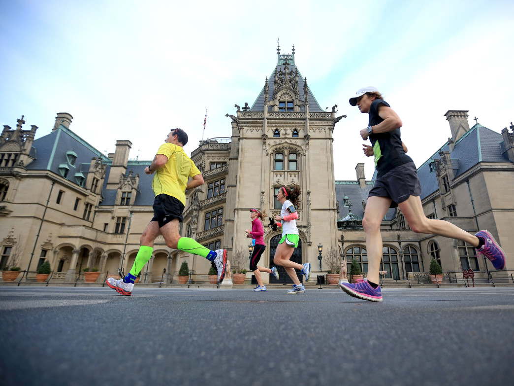 Runners pass by the Biltmore House during the Asheville Marathon and Half-Marathon, held on the grounds of the Biltmore Estate.