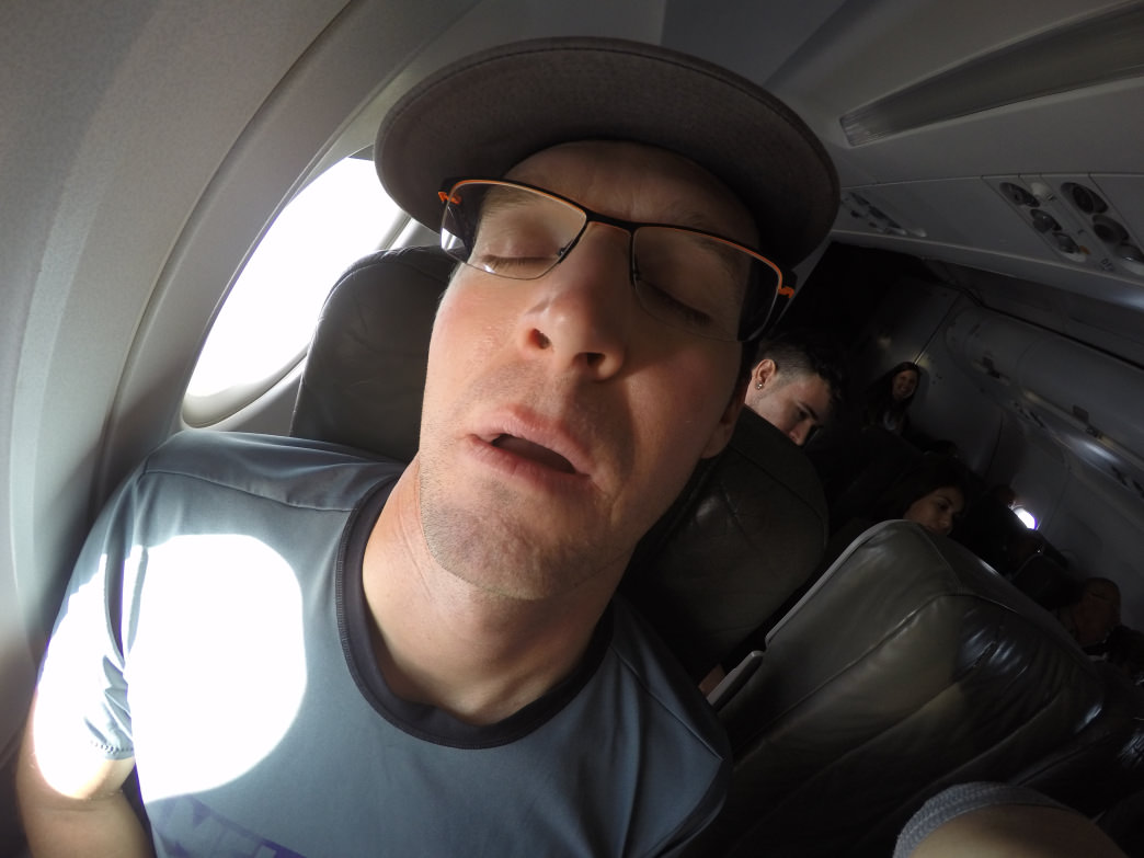 Drew getting some shut-eye (and open-mouth) on the way to Cuba.
