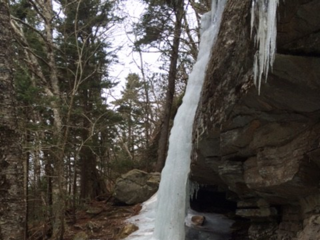 Craggy rock faces create beautiful ice flows on the trail