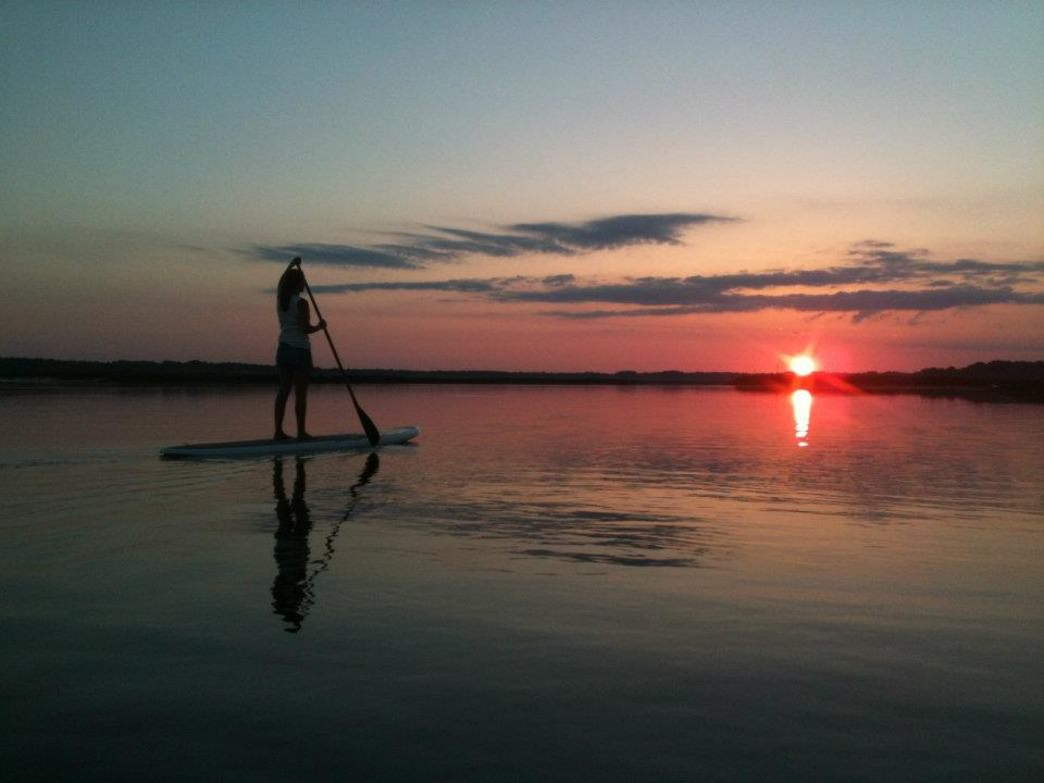 Watersports, like Stand Up Paddle boarding, are a staple of the outdoor scene at Hilton Head