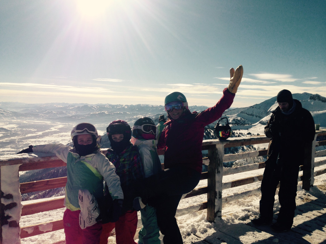 Ski instructor Laura Berger enjoying a blue bird day with some of her young charges.