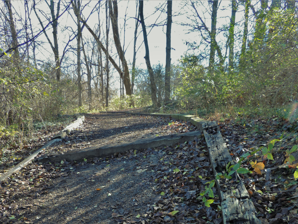 A peaceful stretch of the trail leads past pastures and through rolling woods.
