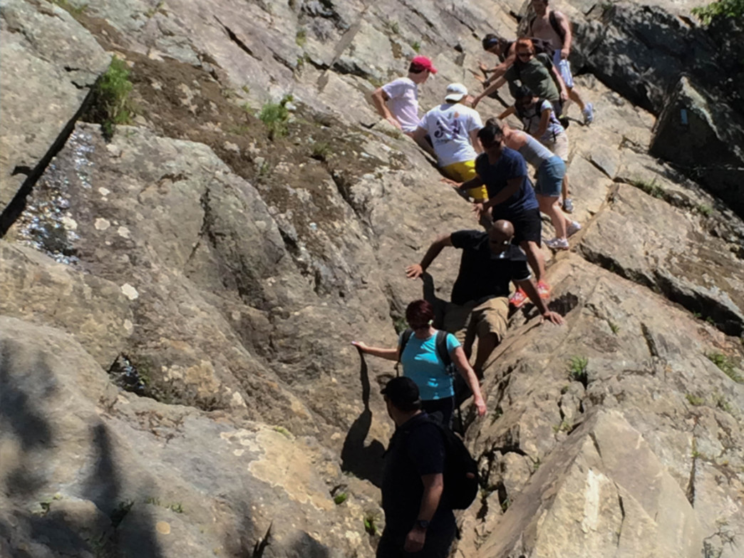 Hikers descend Trail A's most difficult scramble