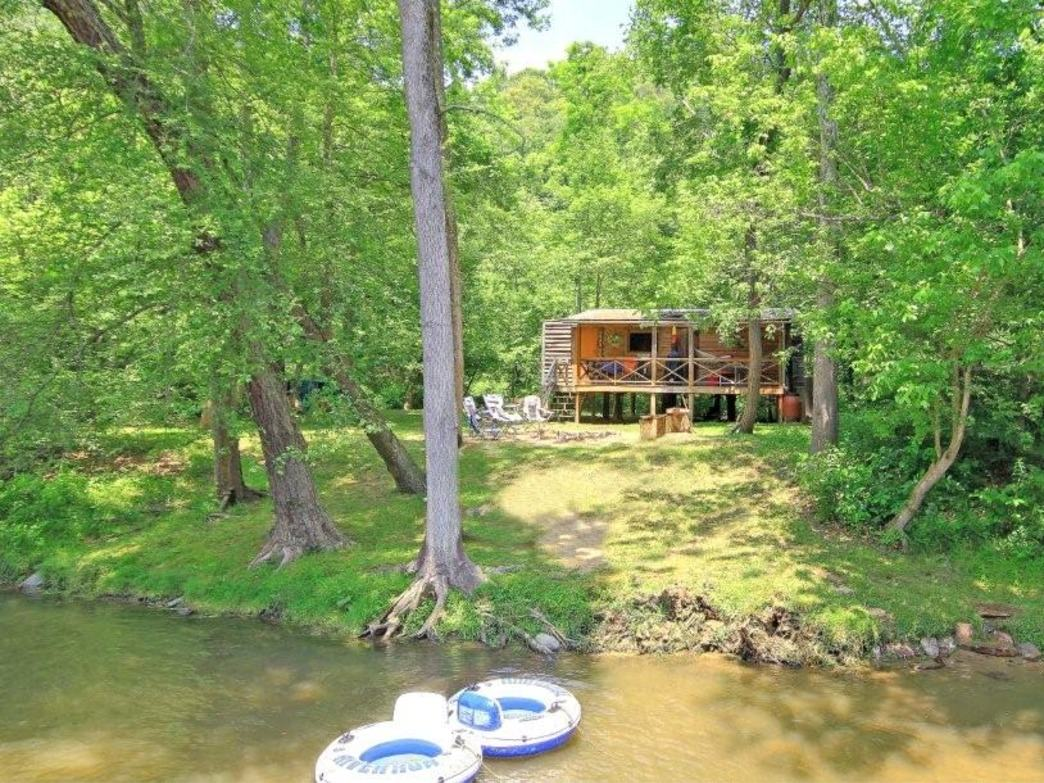 Enjoy an escape on the only private island on the French Broad River.