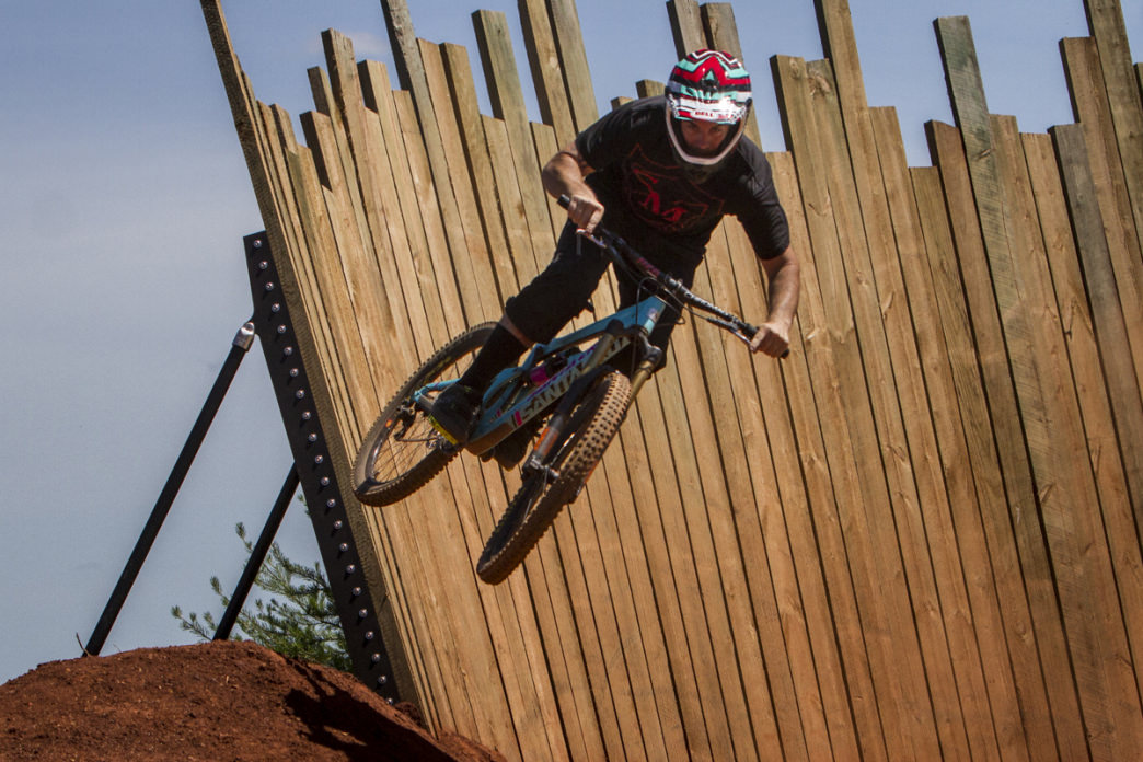 A mountain biker launches off the wall ride on the Devil's Racetrack at Baker Creek Preserve in Knoxville.     Clay Duda