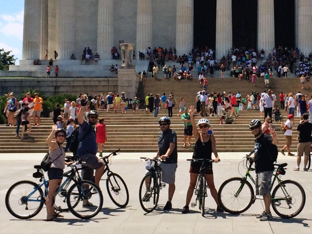Bikers on a self-guided tour stop at Lincoln's Memorial for a photo op