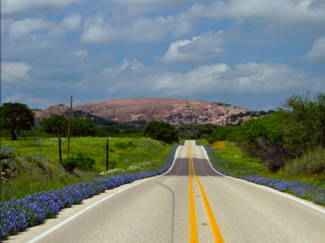 On the way to Enchanted Rock, bluebonnets line the highway. Photo by Timothy J Carroll via Flickr