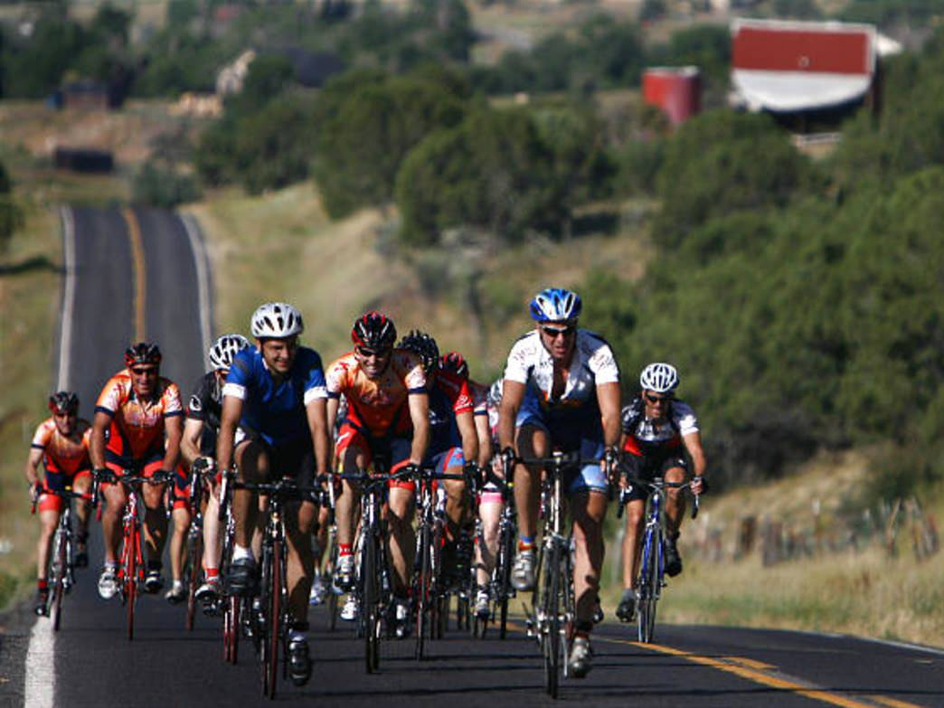 Cyclists climb one of the many rolling hills outside of Park City.