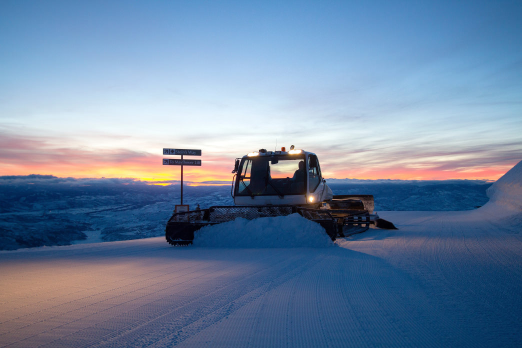 Working with a Snowcat to groom the slopes.