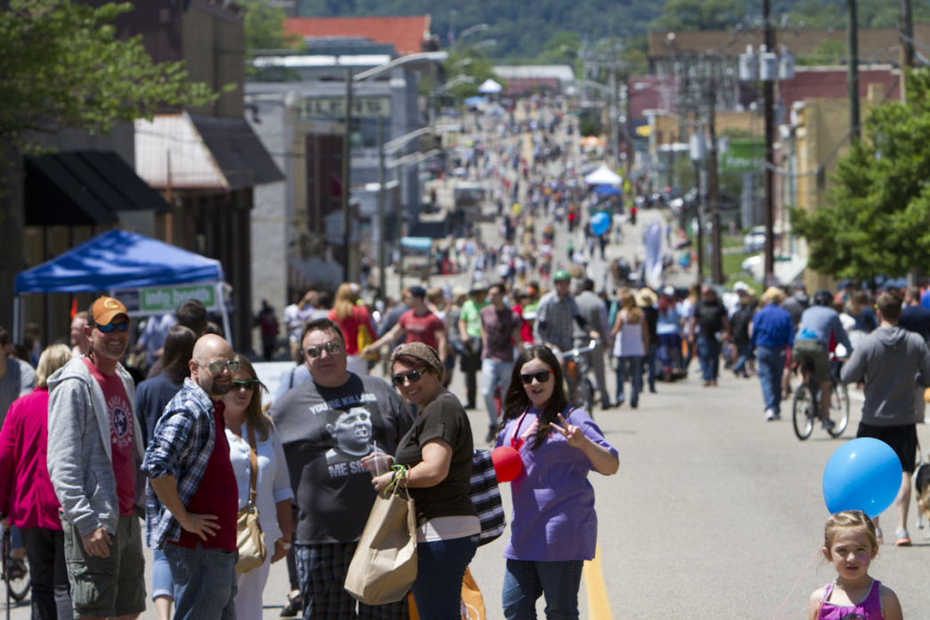 Pedestrians and cyclists take back downtown streets during the bi-annual Open Streets Knoxville events, which shutter intown thoroughfares and clog them with activities and families instead of traffic. 