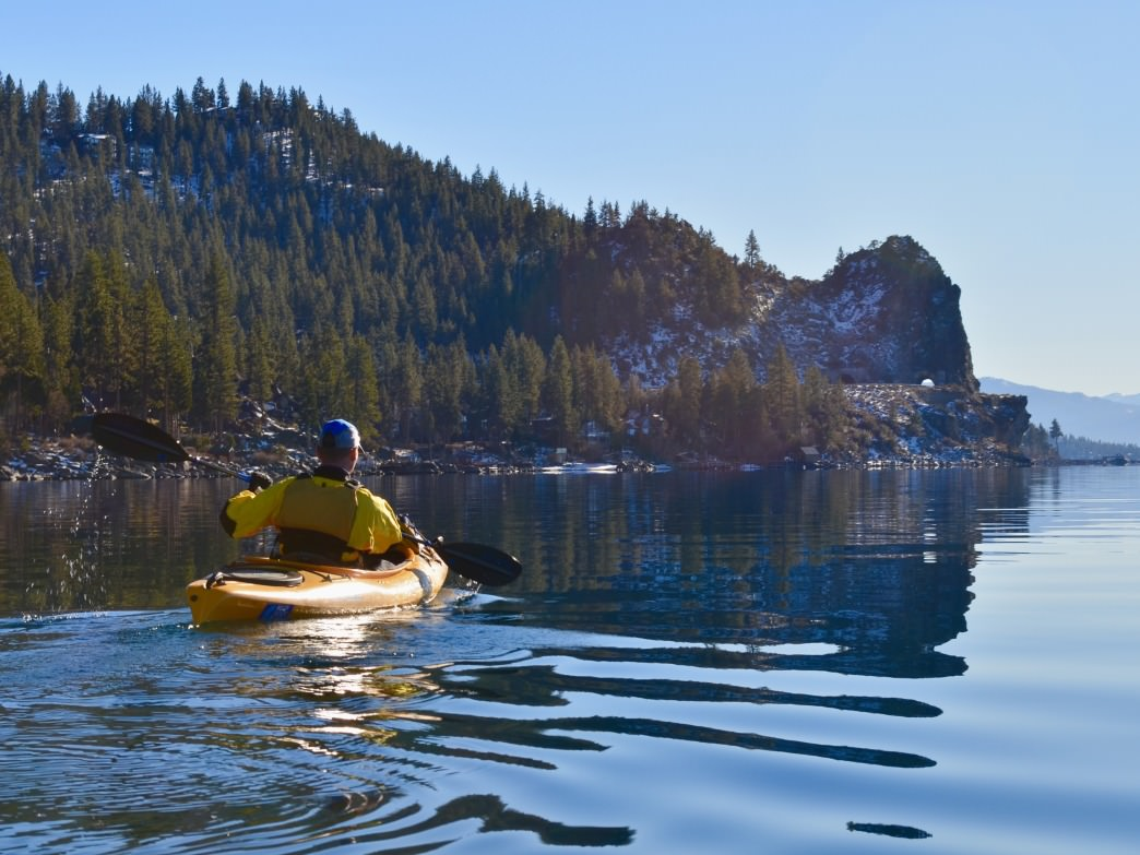 A paddler makes their way toward Cave Rock on Tahoe's east shore