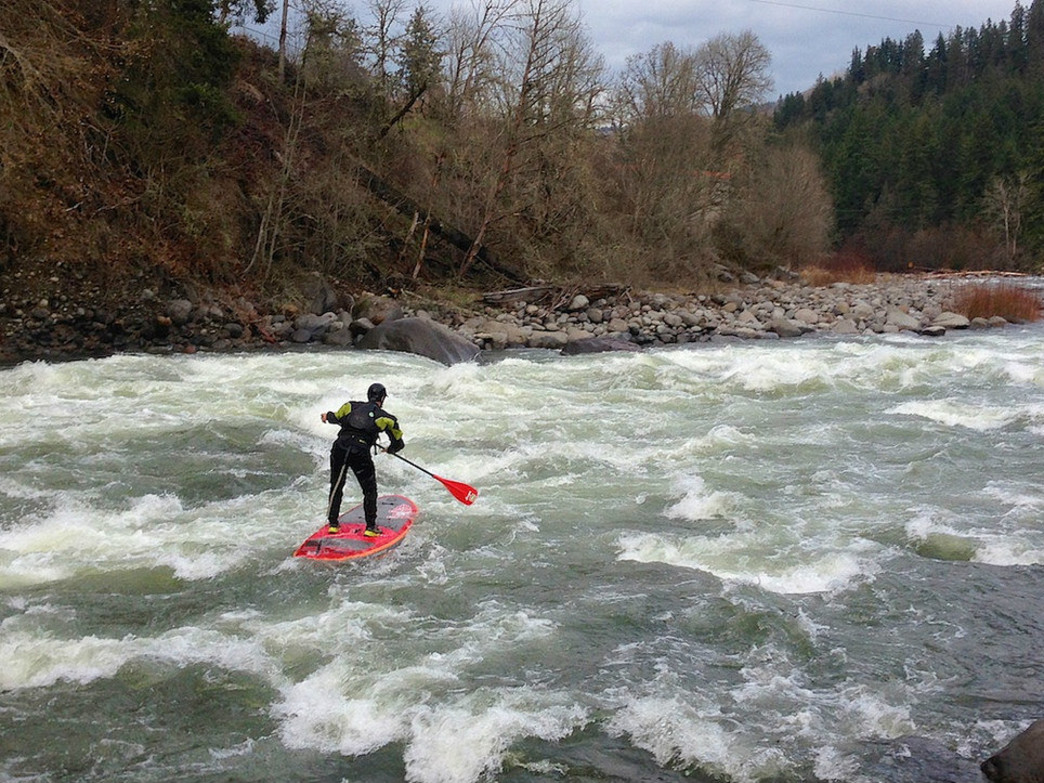 Transitioning to whitewater on a paddle board takes some practice.
