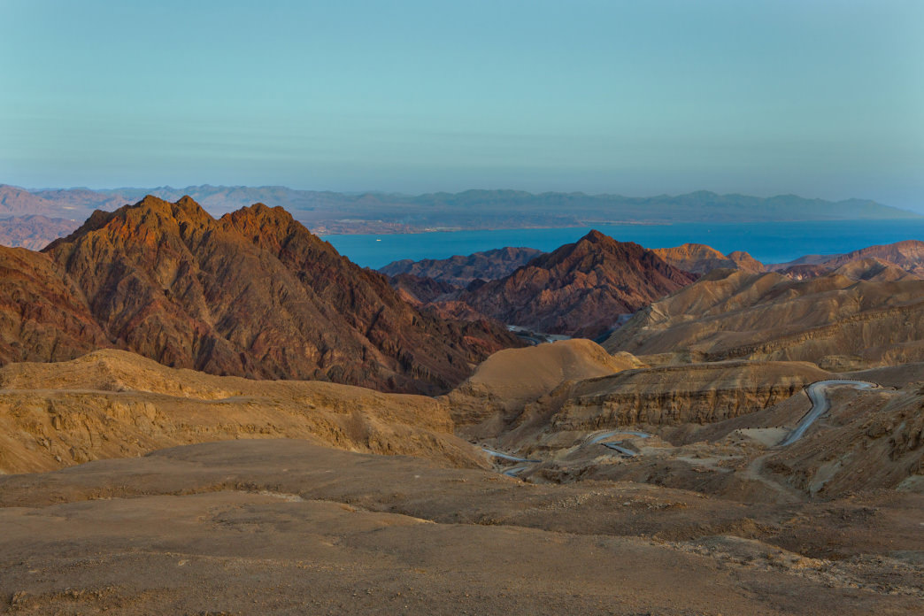 The Negev Desert's Eilat Mountains tumble down to the edge of the Red Sea.