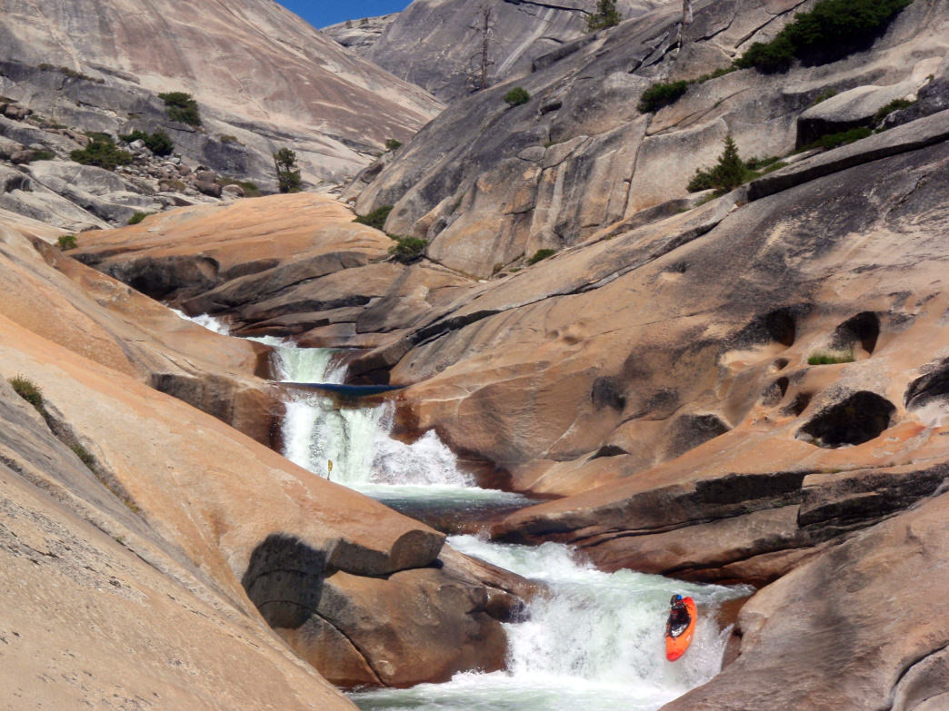 Whitewater kayaking among a sea of rock down California's Tuolumne River.