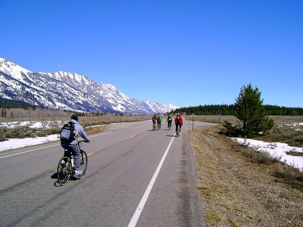 No cars to get in the way on an early spring ride in Grand Teton National Park