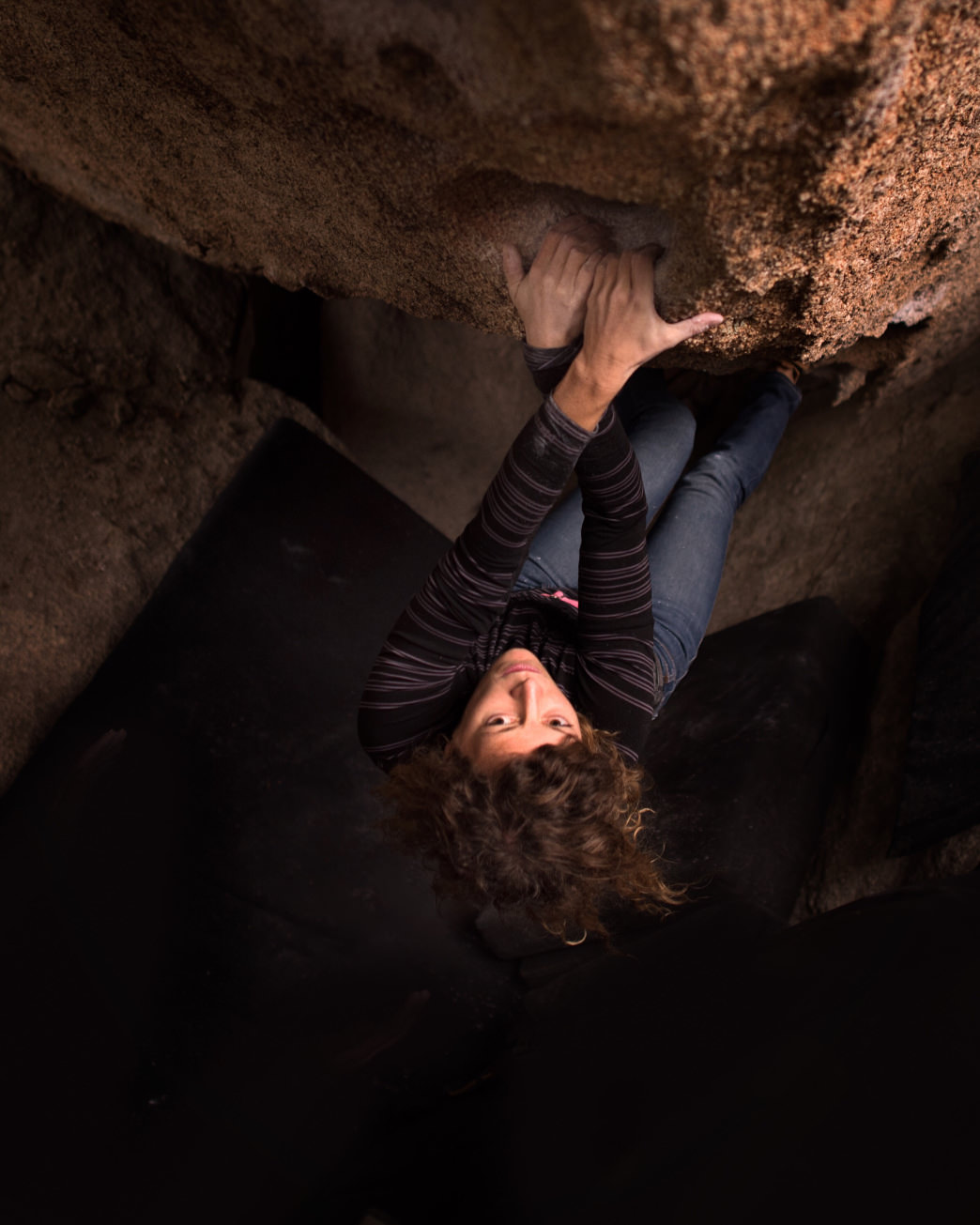 Eyeing up a move on a crag in California.     JESSE WEINER