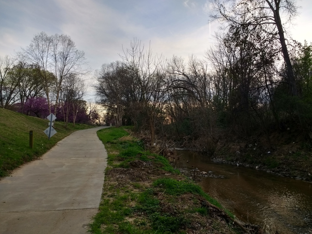 Irwin Creek Greenway runs alongside its namesake creek and offers a natural oasis in the heart of Charlotte.