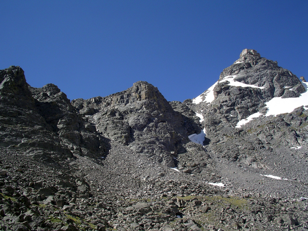 Navajo Peak's impressive summit block. Airplane Gully is the ramp just left of center, left of the rock outcrop in the middle.
