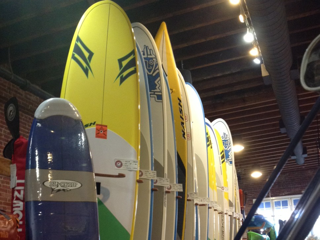 Half-Moon Outfitters stocks a wide range of paddleboards for all skill levels.