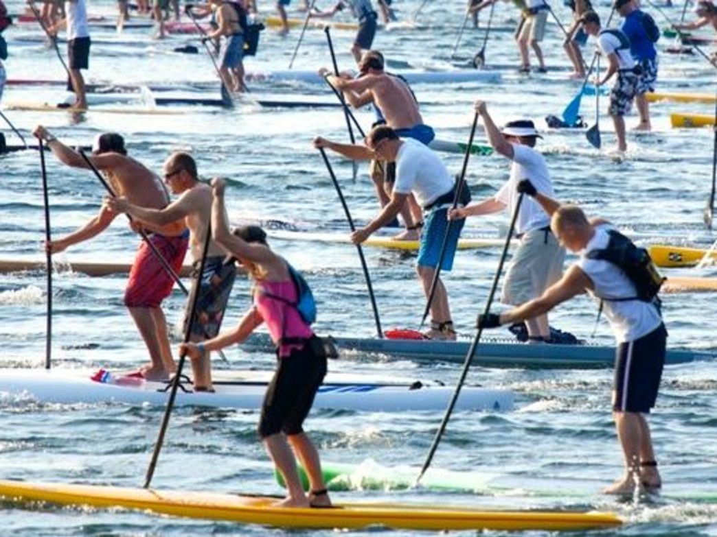Paddlers race to the finish line at the 13-mile Round the Rock SUP race.