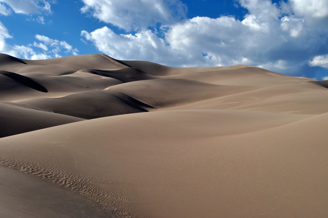 You'll find the largest sand dunes in North America at the Great Sand Dunes National Park.