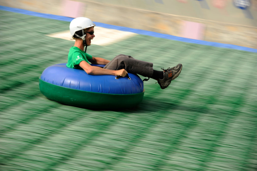 Extreme tubing features a fast ride down the landing hill of the ski jump.