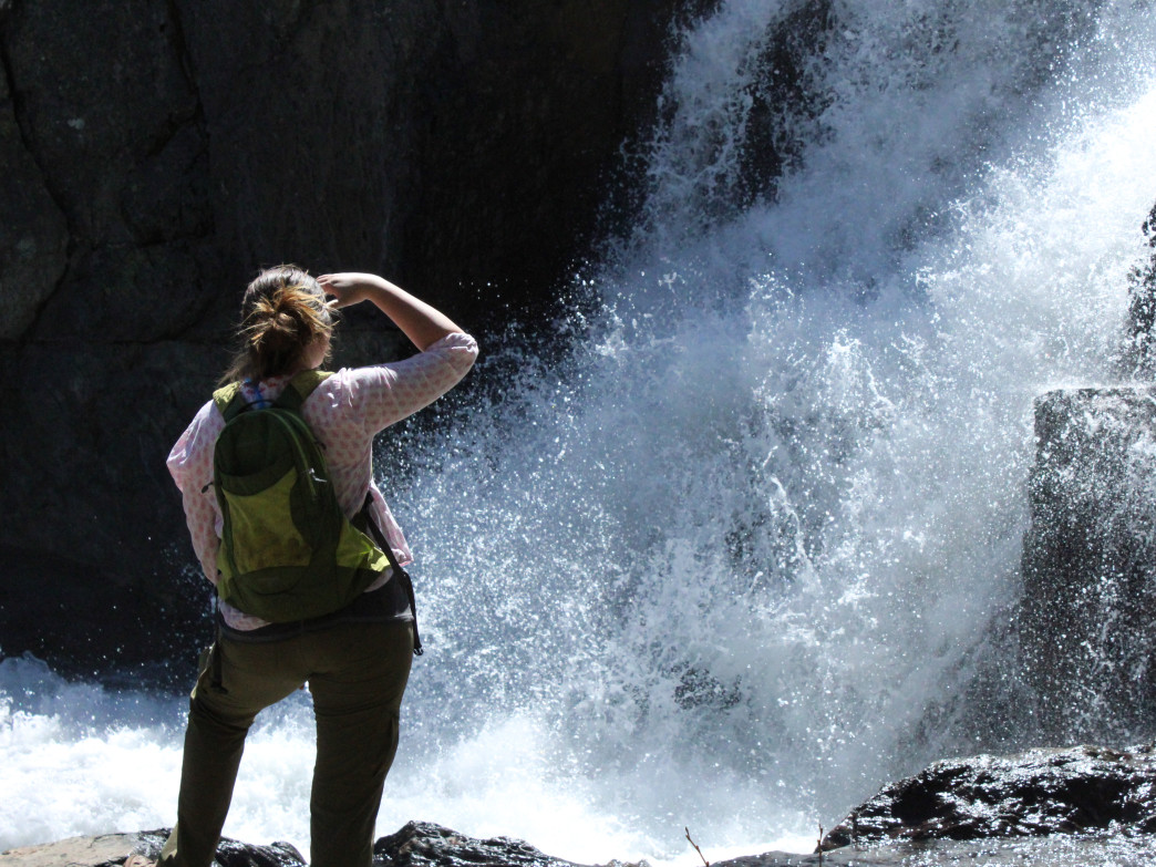 A hiker gazes at one of the many gushing waterfalls dotted around Lake Tahoe.