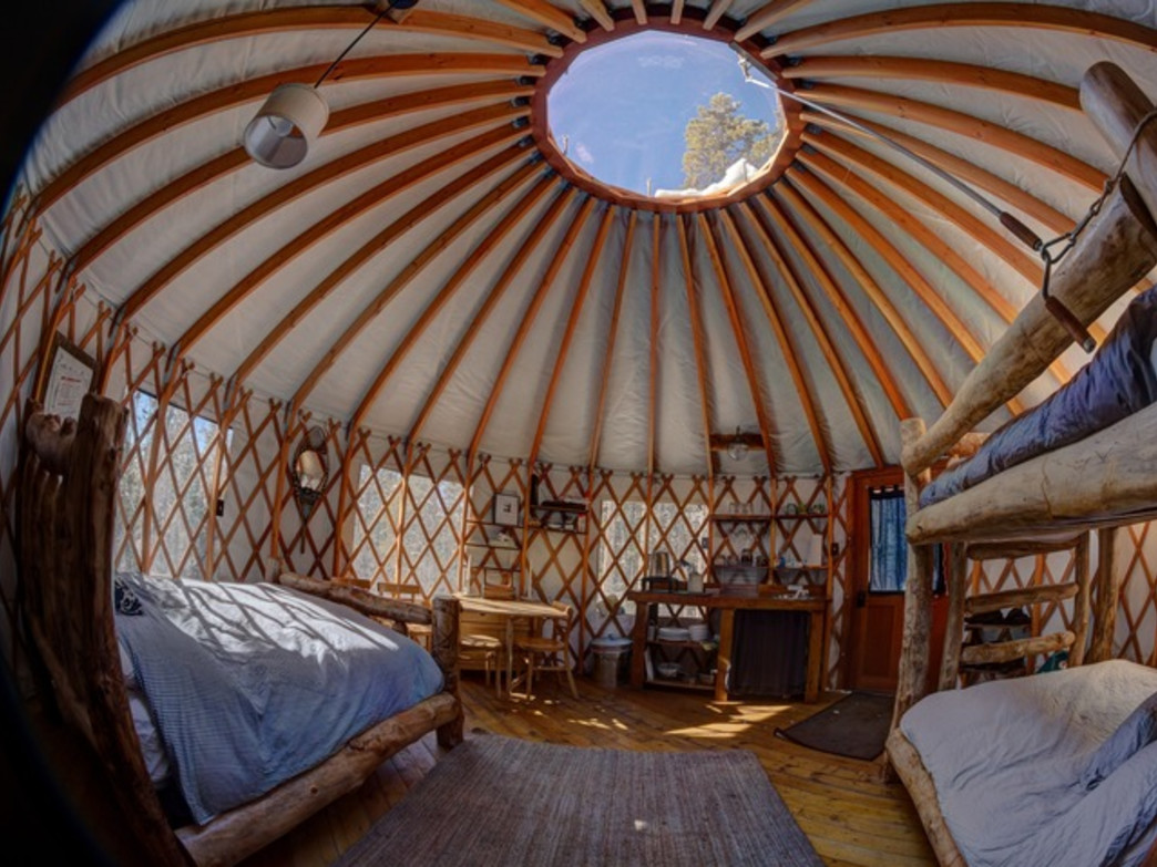 The inside of the Tennessee Pass Sleep Yurts is comfy and inviting.