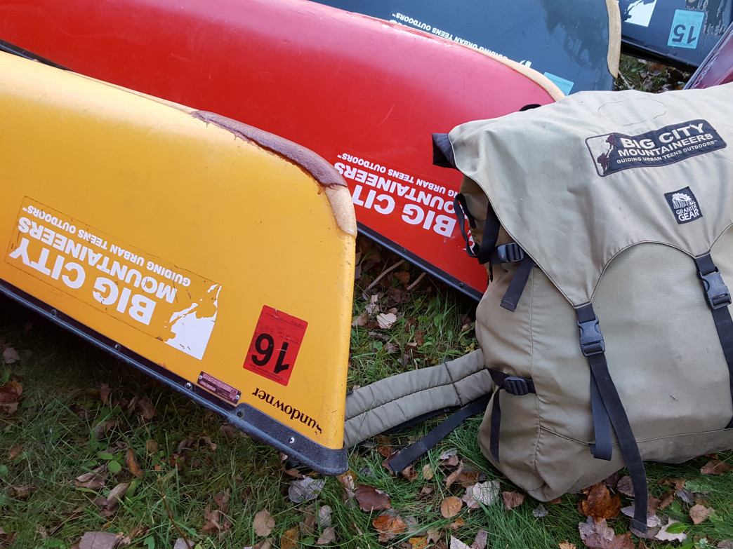 Bombproof bags from Granite Gear and canoes by Wenonah that have been donated to BCM