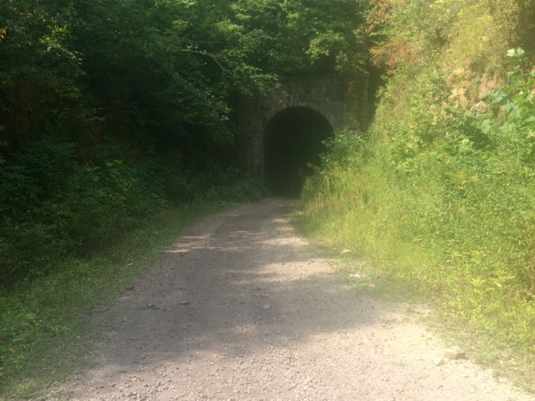 This historic u-shaped tunnel that is pitch black in the center is one of the highlight of this trail.
