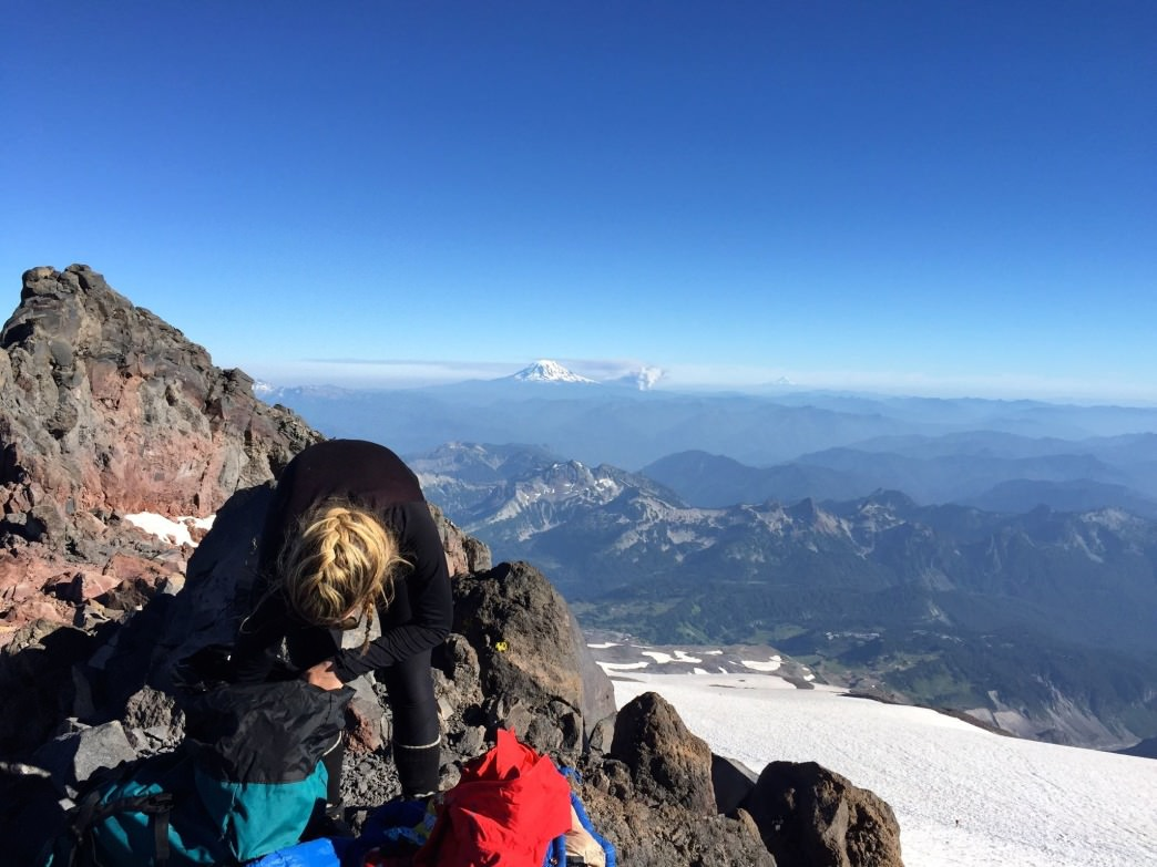 A climber packs her bag before leaving for the summit push.