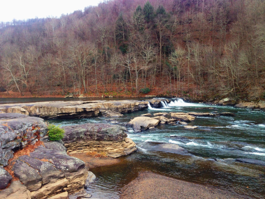 The Tygart River flows through Valley Falls State Park, formerly the site of a grist and lumber mill community.
