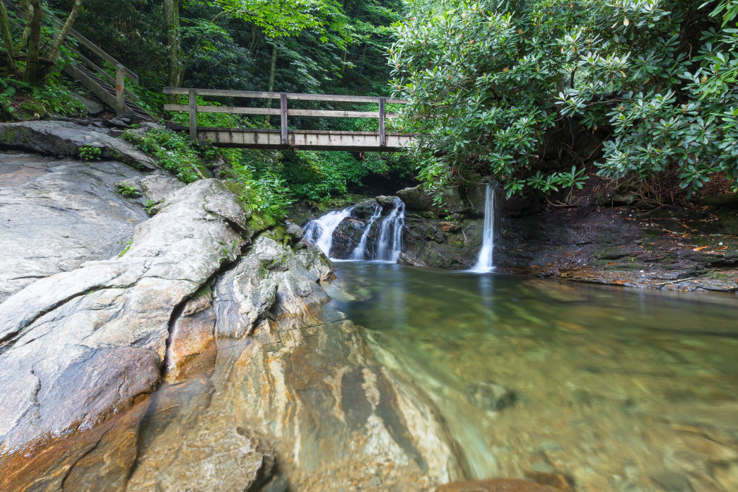Hike the Skinny Dip Falls Trail from the Blue Ridge Parkway to this multi-tiered waterfall and popular summertime swimming hole.