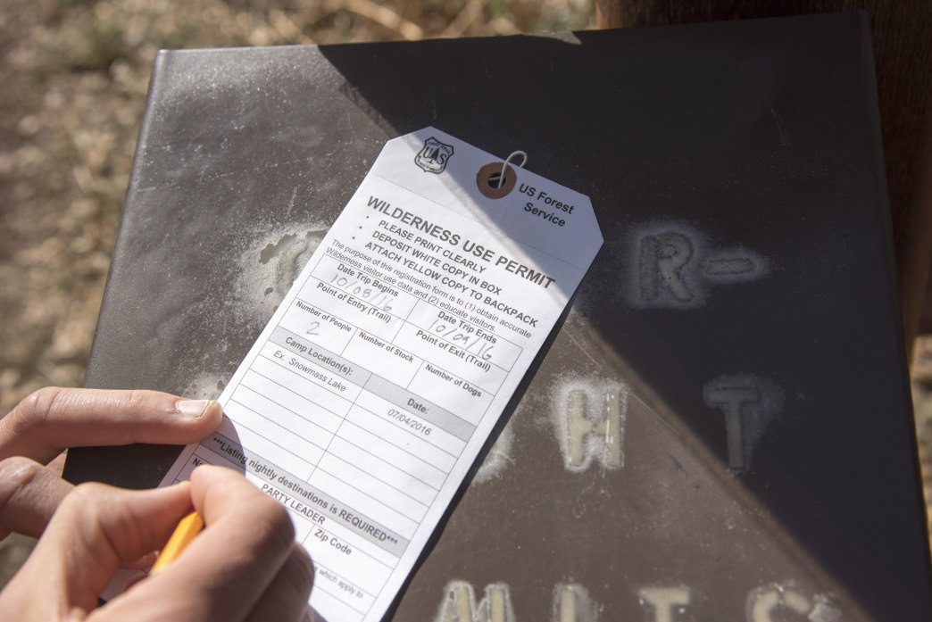 Filling out a Wilderness Use Permit before hitting the trail to Conundrum Hot Springs.