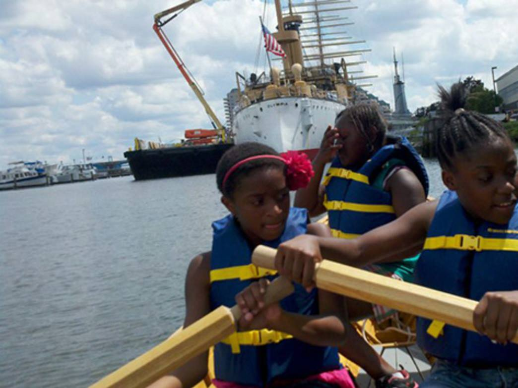 Kids row together at the Delaware River Waterfront.
