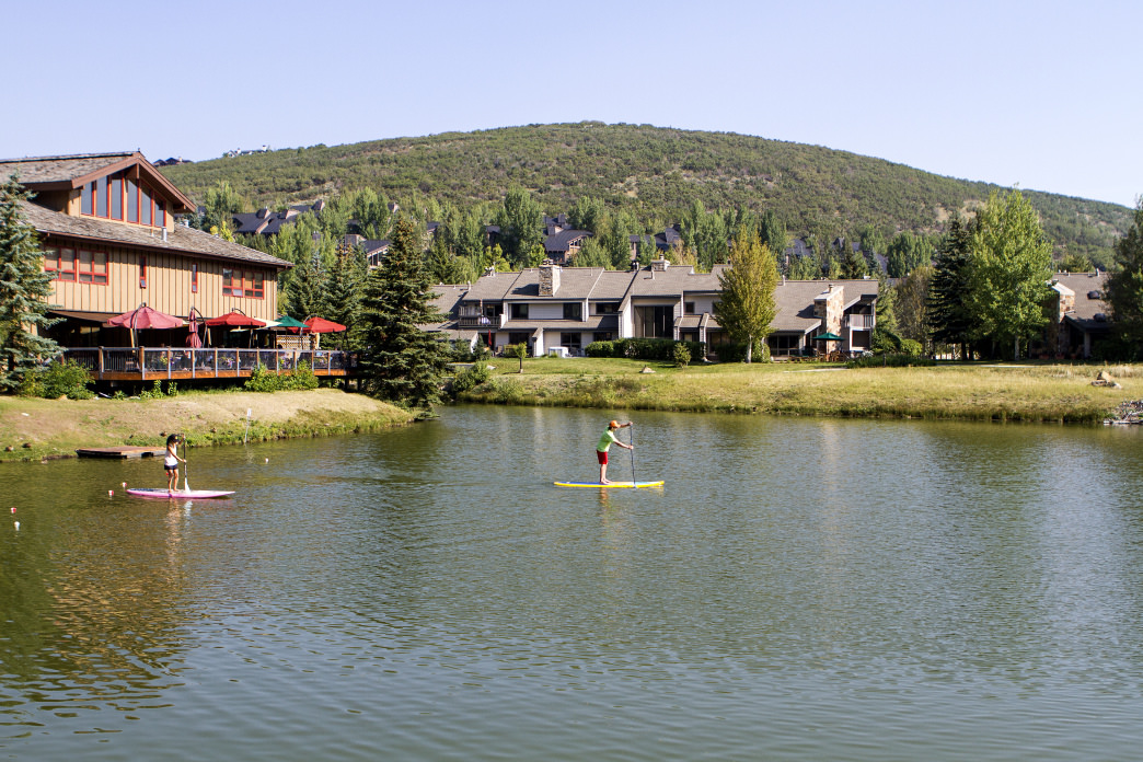 You can learn how to stand-up paddleboard on the calm waters at Deer Valley.